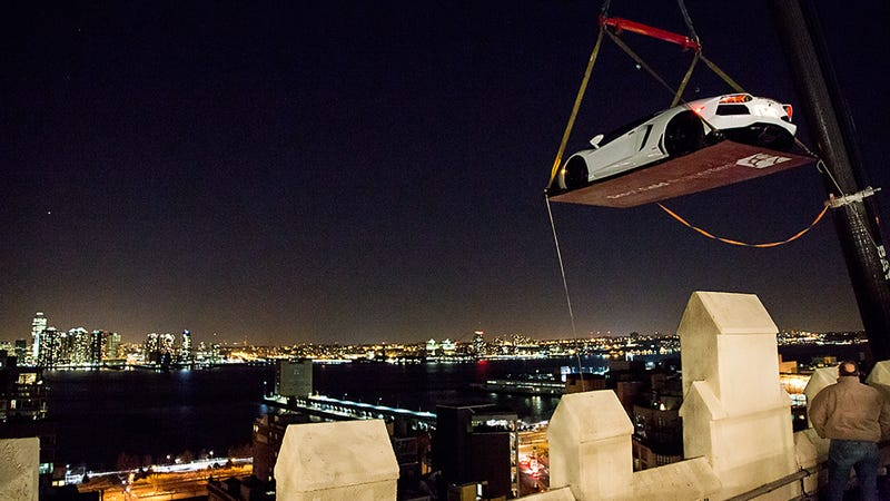 Illustration for article titled This Is A $450K Lamborghini Dangling Over An NYC Rooftop