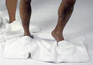 Illustration for article titled Bathmat Slippers Prevent Wet Bathroom Tiles