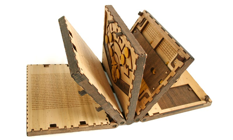 Illustration for article titled You Must Solve a Puzzle to Turn Every Page in This Beautiful Wooden Book