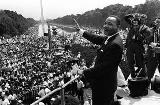"""Civil rights leader Martin Luther King Jr. waves to supporters near the Lincoln Memorial during the March on Washington Aug. 28, 1963. King said the march was """"the greatest demonstration of freedom in the history of the United States.""""AFP/Getty Images"""