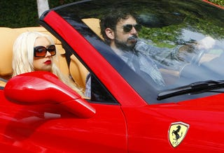 Illustration for article titled Christina Aguilera Coordinates Her Lipstick And Her Ferrari