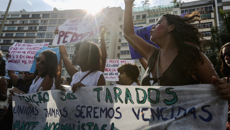 Protesters at the International Women's Day march in Rio de Janeiro, Brazil. Image via Getty.