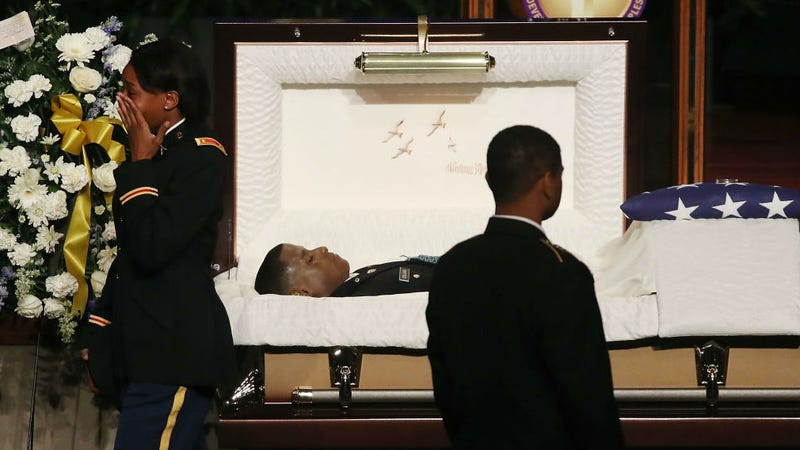 Mourners pay their respect during a funeral service for Army 2nd Lt. Richard Collins III, on May 26, 2017, in Upper Marlboro, Md.