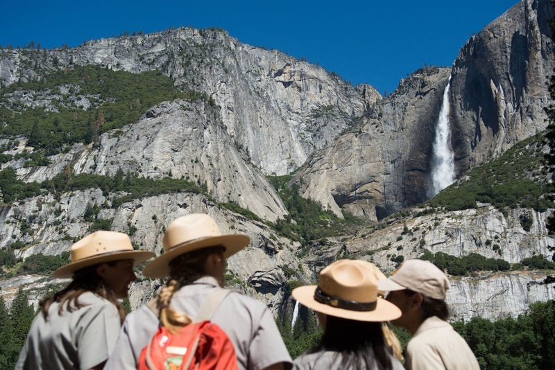 Park rangers in front of Yosemite Falls in June 2016 (Photo by David Calvert/Getty Images)