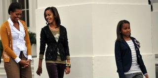 Michelle, Malia and Sasha Obama (AFP/Getty Images)