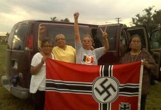Illustration for article titled AWESOME ALERT: Badass Native Grannies Capture, Burn NeoNazi Flag