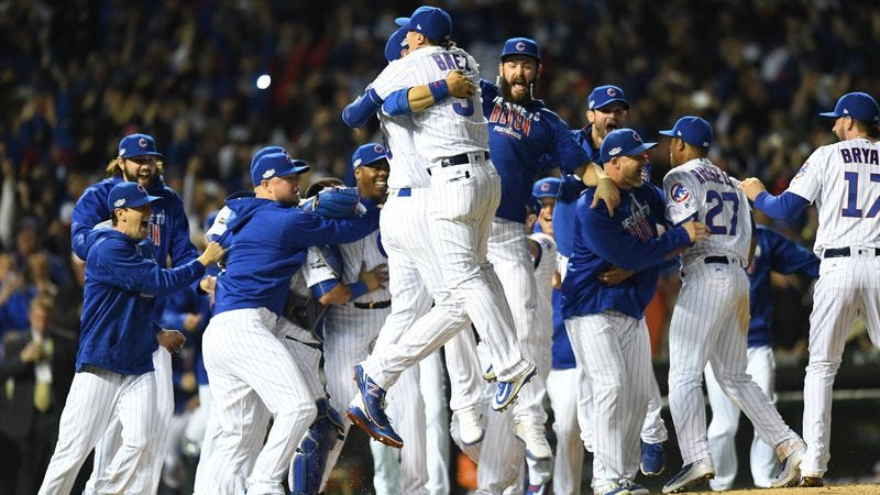 Chicago Cubs third baseman Javier Baez jumps with his team after winning the National League Championship. (Photo by Patrick Gorski/Icon Sportswire/Getty Images)