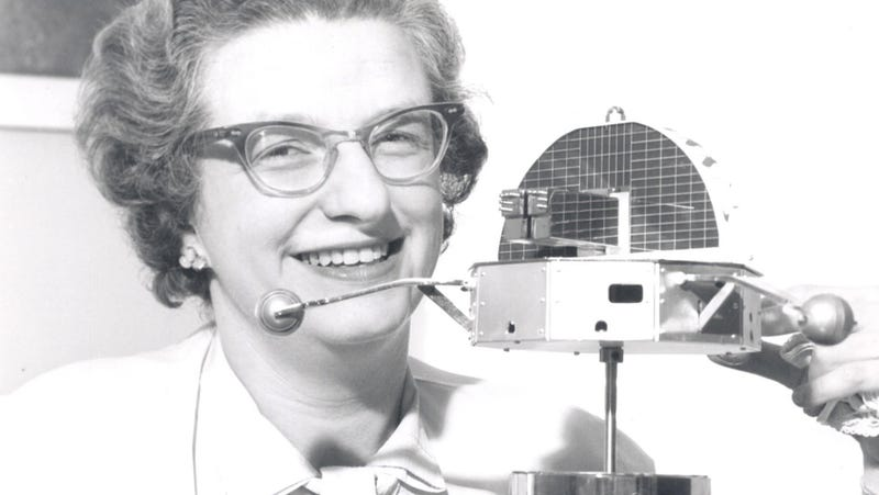 Dr. Nancy Grace Roman, NASA's first Chief of Astronomy, poses with a model of the Orbiting Solar Observatory (OSO) in 1962.