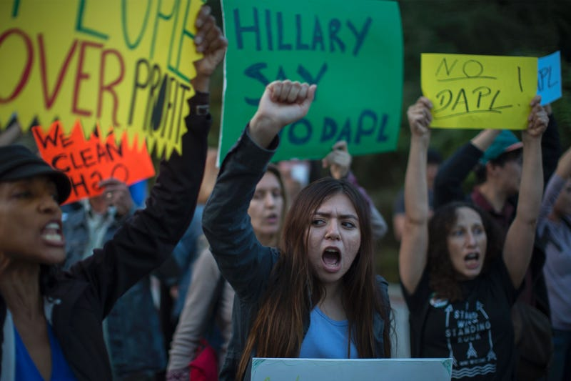 Activists demonstrate near a Hillary Clinton presidential-campaign fundraiser with President Barack Obama to call for a halt to the Dakota Access Pipeline project Oct. 24, 2016, in Beverly Hills, Calif. DAVID MCNEW/AFP/Getty Images