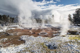 Illustration for article titled The Beauty of Yellowstone's Fountain Paint Pots In the Cold