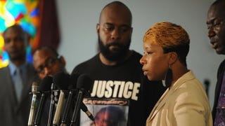 Michael Brown's mother, Lesley McSpadden, flanked by his father, Michael Brown Sr., speaks during a press conference at Jennings Mason Temple Church of God in Christ, Aug. 11, 2014, in Jennings, Mo.Michael B. Thomas/Getty Images
