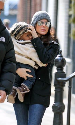 Illustration for article titled Sandra Bullock Keeps The Baby Bundled Up