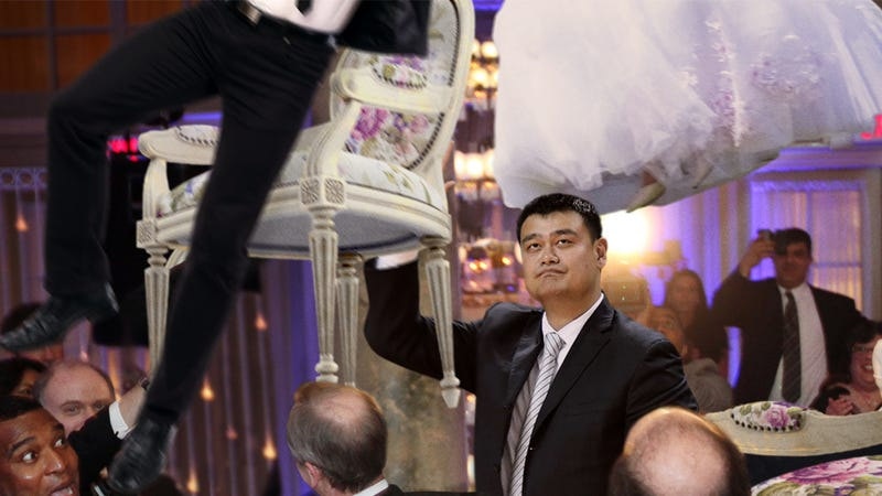 Illustration for article titled Complete Disaster: Yao Ming Has Ruined A Jewish Wedding By Accidentally Hoisting The Married Couple Through A Ceiling During The Hora