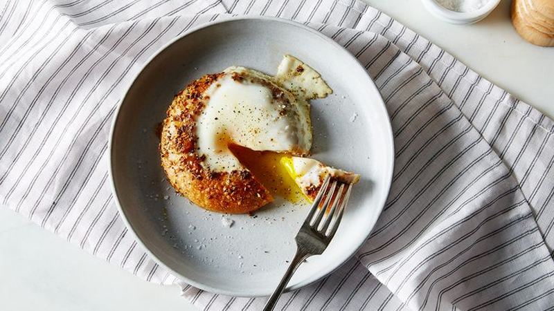 Illustration for article titled Make a Bagel Egg-in-a-Hole for an Upgraded Breakfast for Two