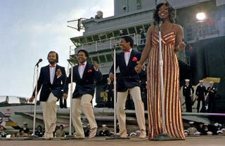 """Gladys Knight and the Pips perform aboard the aircraft carrier USS Ranger: William """"Red"""" Guest, Edward Patten, Merald """"Bubba"""" Knight and Gladys Knight.U.S. Department of Defense via Wikimedia Commons"""