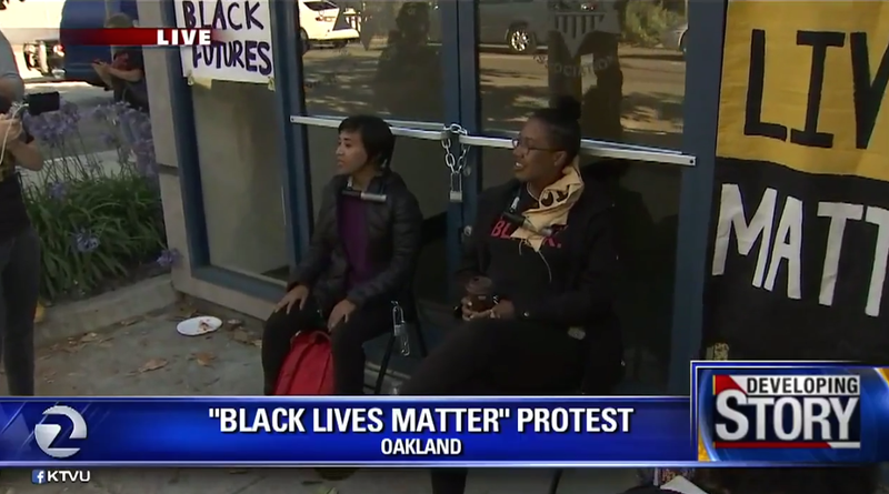 Protesters U-locked themselves to the door of a police union headquarters in Oakland, Calif.KTVU screenshot