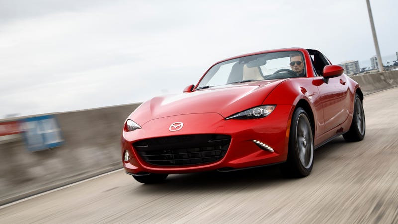 The 2017 Mazda Miata, driven by a dude, as is the case with almost all press photos.