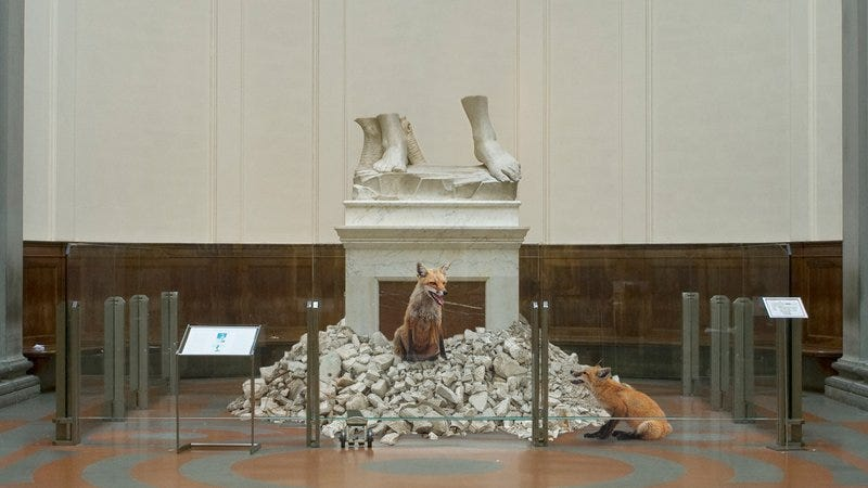 Michelangelo's David being destroyed by foxes.
