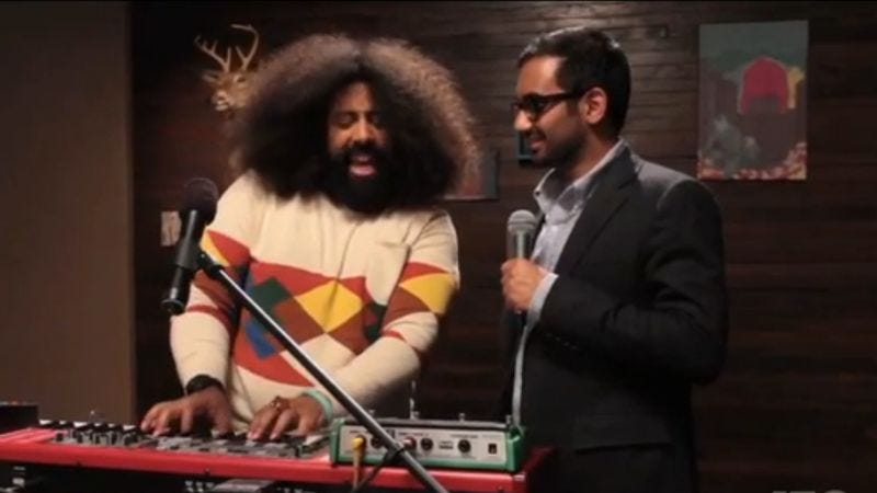Illustration for article titled Watch Reggie Watts and Aziz Ansari sing a tender duet about a sandwich date