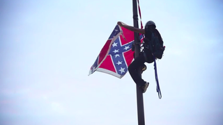 Bree Newsome as she removes the Confederate flag from a pole on the Capitol grounds in South Carolina June 27, 2015Youtube Screenshot