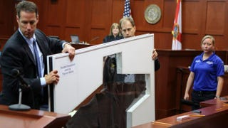Assistant state attorneys John Guy and Richard Mantei hold up Trayvon Martin's hoodie as evidence during George Zimmerman's trial in Seminole County circuit court June 25, 2013, in Sanford, Fla. Pool
