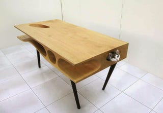 Illustration for article titled At Last, a Magical Desk That You Can Share With Your Cat