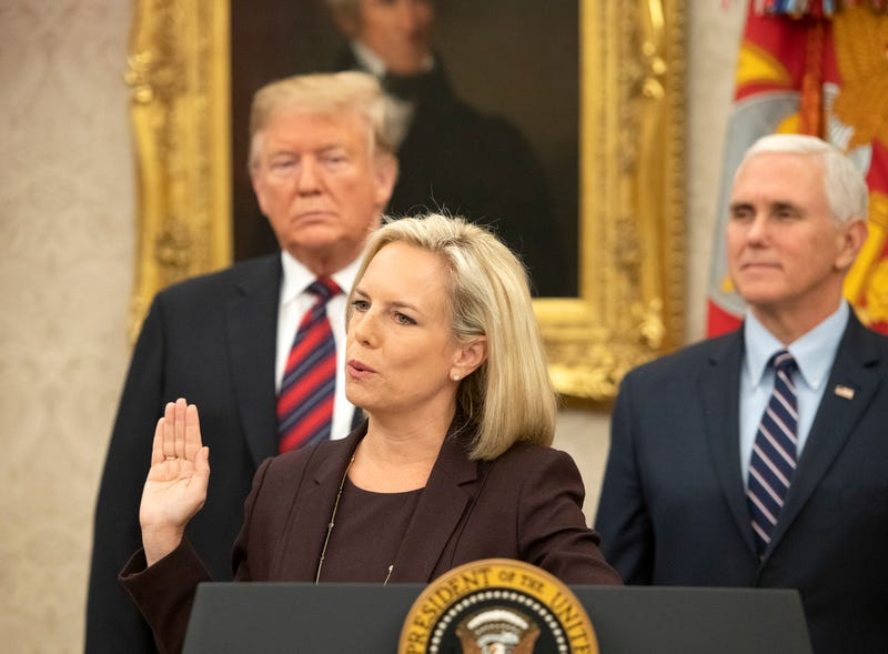 United States Secretary of Homeland Security (DHS) Kirstjen Nielsen, center, administers the oath of citizenship to five people as U.S. President Donald Trump, left, and Vice President Mike Pence, right look on during a naturalization ceremony in the Oval Office of the White House in Washington, DC on Saturday, January 19, 2019.