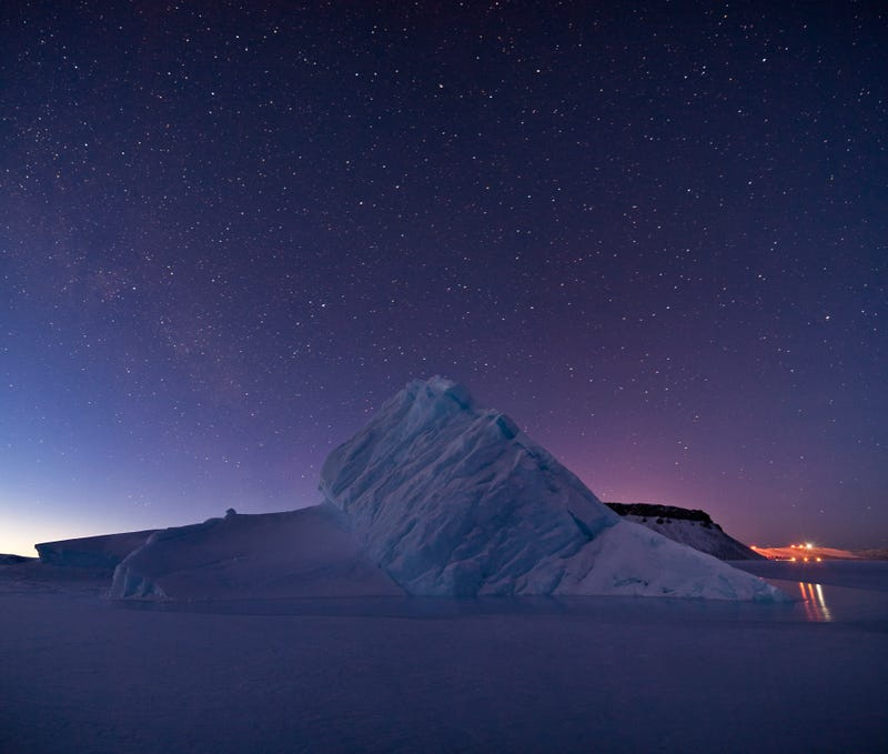 Illustration for article titled An Iceberg Rises Above The Frozen Water Of Greenland's North Star Bay