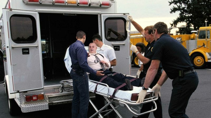 Illustration for article titled Man On Gurney Has Brief Word With Protagonist Before Entering Ambulance