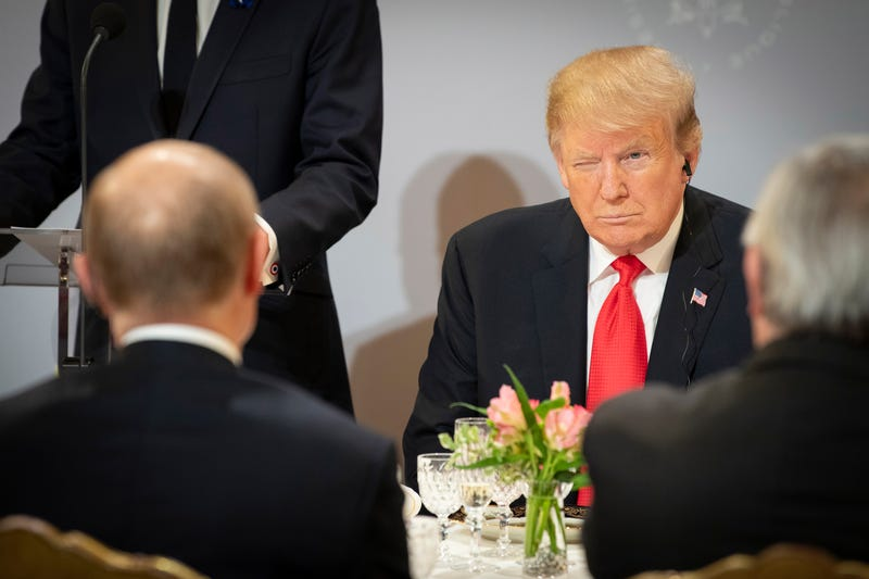 President Donald Trump sits opposite Russian President Vladimir Putin during lunch at the Elysee Palace during the occasion of the commemoration ceremony of the 100th anniversary since the end of The First World War on November 11, 2018 in Paris, France.
