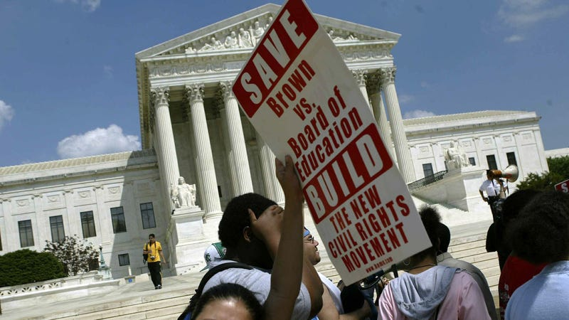 Activists organized by BAMN (By Any Means Necessary) rally in front of the US Supreme Court to mark the anniversary of the Brown vs Board of Education decision May 15, 2004 in Washington, DC.