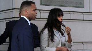 Former Rep. Jesse Jackson Jr. and his wife, Sandi Jackson, leave the federal courthouse after being sentenced to prison Aug. 14, 2013, in Washington, D.C.Mark Wilson/Getty Images