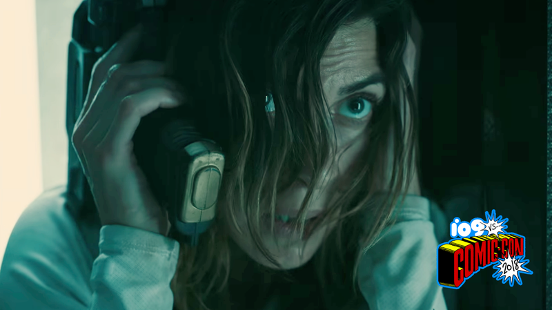 Lana (Natalia Tena) is trying to make a phone call with her gun. It's not working.