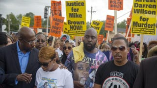Lesley McSpadden (second from left) and Michael Brown Sr. (center), parents of Michael Brown, participate in a protest march for their son Aug. 30, 2014, in Ferguson, Mo. Aaron P. Bernstein/Getty Images