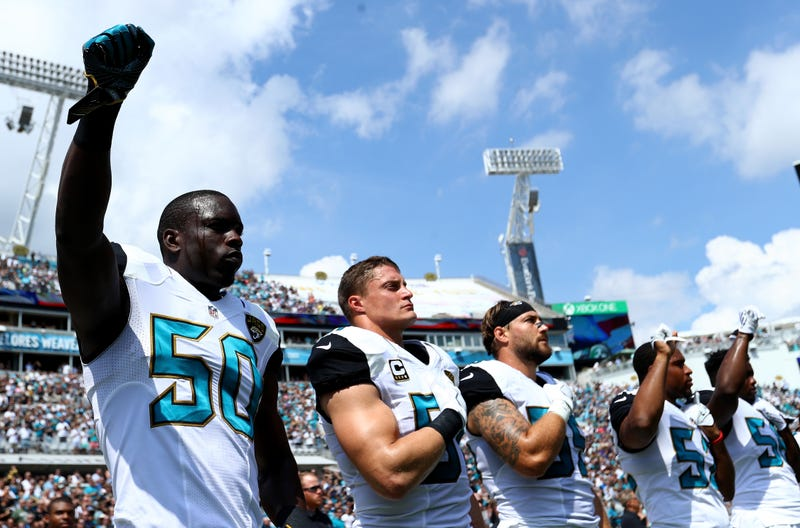 Telvin Smith #50 of the Jacksonville Jaguars raises his arm in protest with teammates during the National Anthem prior to the game against the Baltimore Ravens at EverBank Field on September 25, 2016 in Jacksonville, Florida.