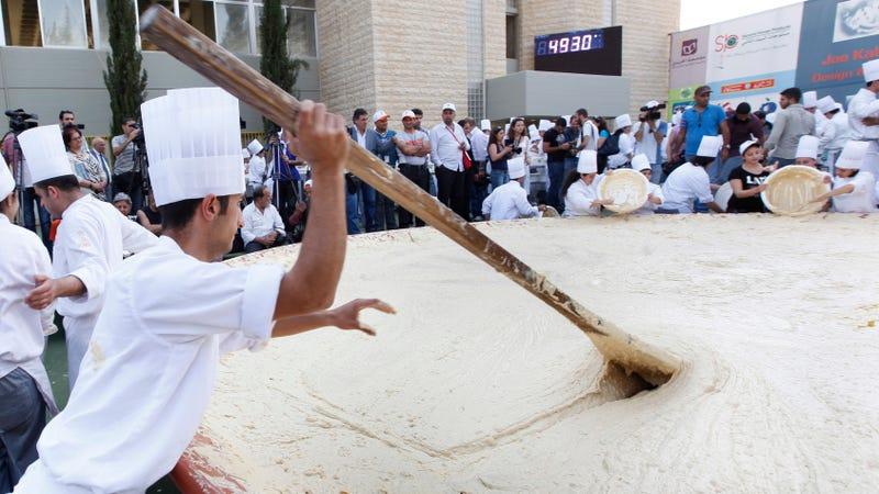 Photo of Lebanese chefs preparing 22,000 pounds of hummus via Hussein Malla/AP