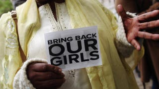 """A woman holds a sign that reads """"Bring Back Our Girls"""" during a protest outside the Nigeria House in London on May 9, 2014.Dan Kitwood/Getty Images"""