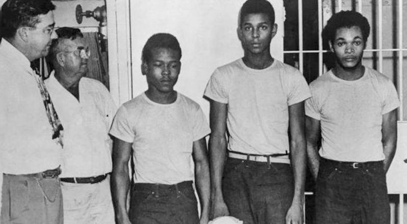 In this undated image released by the State Library and Archives of Florida, Lake County Sheriff Willis McCall, far left, and an unidentified man stand next to Walter Irvin, Samuel Shepherd and Charles Greenlee, from left, in Florida. The three men along with a fourth were charged with rape in 1949. Florida Gov. Ron DeSantis and a Cabinet granted posthumous pardons Friday, Jan. 11, 2019, to Shepherd, Irvin, Charles Greenlee and Ernest Thomas, the four African-American men accused of raping a white woman in 1949 in a case now seen as a racial injustice.