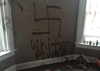 "Pat and Joe Jude returned to their Cincinnati home to find swastikas and the words ""White Power"" scrawled on their walls.WLWT Screenshot"