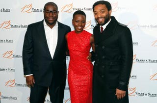 Steve McQueen is flanked by Lupita Nyong'o and Chiwetel Ejiofor at a premiere of 12 Years a Slave on December 11, 2013 in Paris.FRANCOIS GUILLOT/AFP/Getty Images