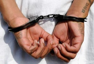 Handcuffs on the hands of a youth arrested by Los Angeles police on April 29, 2012Kevork Djansezian/Getty Images