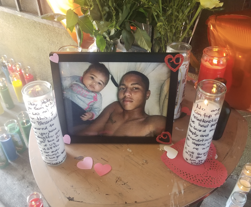 """A photo of Anthony """"A.J."""" Weber with his daughter, 9-month-old Viola, at a makeshift shrine at the site of his death (Black Lives Matter Los Angeles)"""