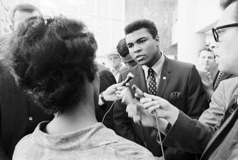 Muhammad Ali talking with the press after being indicted by a federal grand jury for his refusal to be inducted into the armed forces.Getty Images