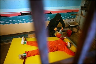 Illustration for article titled Robots Act Out Guantanamo Waterboarding Torture, Terrorists Win