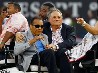 Muhammad Ali with Miami Marlins owner Jeffrey Loria (Mike Ehrmann/Getty Images)