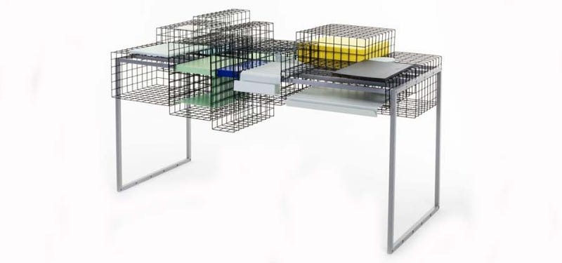 Illustration for article titled You Can Customize This Desk's Modular Cages In Countless Ways