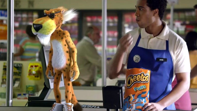Illustration for article titled 'Why Would A Cat Be Here?': 5 Cheetos Commercials Where Chester Cheetah Openly Questions What The Hell He's Doing In A Commercial For Cheese Snacks