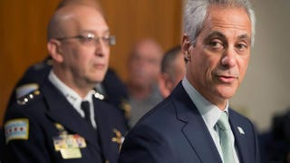 Interim Chicago Police Superintendent John Escalante (left, background) listens as Chicago Mayor Rahm Emanuel addresses upcoming changes in training and procedures within the Chicago Police Department on Dec. 30, 2015.Scott Olson/Getty Images