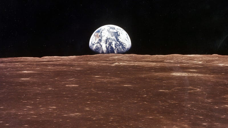 A view of the Earth appears over the Lunar horizon.
