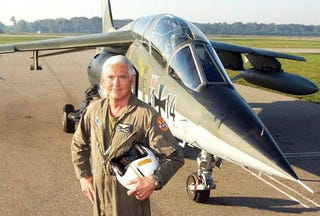 """Illustration for article titled """"Maximum"""" Bob Lutz Buzzes Town In Fighter Jet, Causes Chaos"""